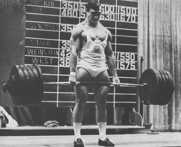 Bill Starr deadlifting in loafers.